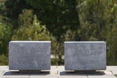 Two cube-shaped stone seats Stock Photo