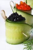 Two cucumber rolls with red and black caviar Royalty Free Stock Photography