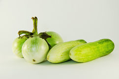 Two cucumber and three eggplant Royalty Free Stock Photos