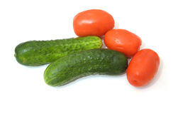 Two cucumber and three tomatoes. Royalty Free Stock Photography