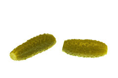 Two cucumbers. Pickles located on a white background royalty free stock photos