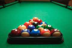 Two cues and pyramid on a billiard table. Royalty Free Stock Images