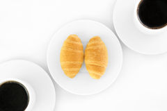 Two cup of coffe and croissants. In white background Royalty Free Stock Photo