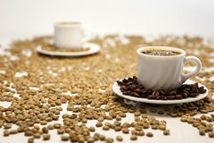 Two Cup of coffee on beans. Cup of coffee on coffee beans  on white Stock Images