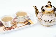 Two cup of coffee on a tray with white background. Two cup of coffee this, coffee is made by milk.with a kettle,white background Stock Photography