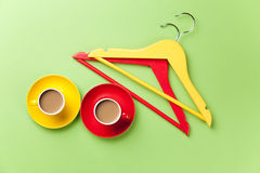 Two cup of coffee and hangers Royalty Free Stock Photos