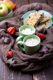 Two cup of coffee or hot chocolate with marshmallow near knitted blanket and pie. Autumn concept. Christmas. Royalty Free Stock Images