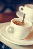 Two Cup Of Coffees. Two Cups Of Coffee On Wooden Table In Cafe Stock Photography