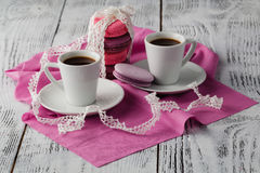 Two cup of espresso coffee with macaroons on pink background Stock Photography