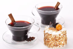 Two cup with glintwine and cake. Two cup with glintwine and almonds cake Stock Photography