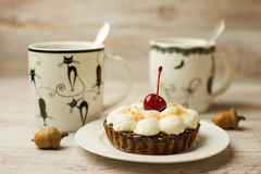 Two Cup of tea and cake  on the table Stock Images