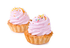 Two cupcakes. Two tasty cupcakes on white background Royalty Free Stock Photos