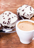 Two cupcakes with a cup of coffee Royalty Free Stock Photos