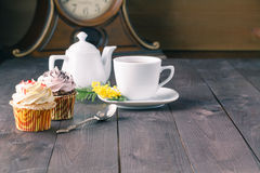 Two cupcakes on dark wooden table Stock Photos