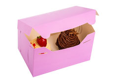 Two Cupcakes are in the Delivery Box over white background.  Stock Photography