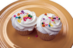 Two cupcakes on a yellow plate Stock Image