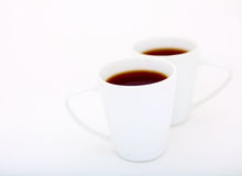 Two cups. Two white cups on a white background Royalty Free Stock Images