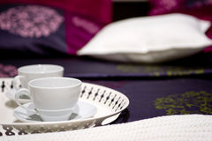 Two cups on a bed Stock Photo