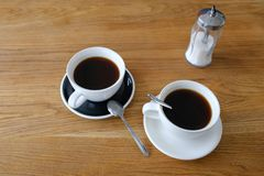 Two cups of black cofffee on wood table, morning coffee stock photography