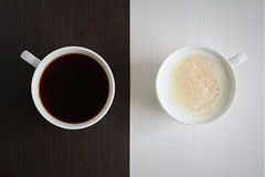 Two cups of black and white coffee Stock Images