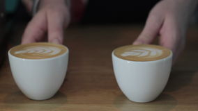 Two Cups of Cappuccino. At the bar in a cafe stock video footage