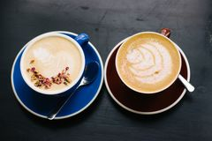 Two cups of cappuccino with latte art. stock photo