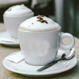Two cups of cappuccino at an outdoor cafe Royalty Free Stock Photo