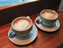 Two cups of cappuccino on table. Two cups of cappuccino on the table Royalty Free Stock Photography