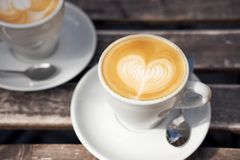 Two cups of cappuccino on the table royalty free stock photo
