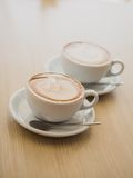 Two cups of cappuccino on the table Stock Photo