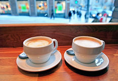 Two cups of cappuccino Royalty Free Stock Photos