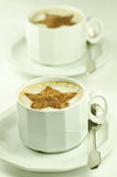 Two cups of capuccino on white background Stock Photos