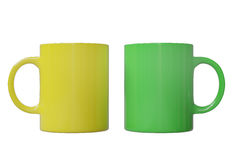 Two cups. Two ceramic cups, yellow and green, isolated on white background. 3d image Royalty Free Stock Photos