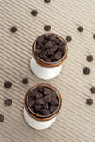 Two cups of chocolate chips Royalty Free Stock Photos