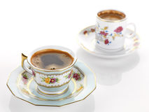 Two cups of coffee. Two cups of greek coffee in vintage porcelain sets Stock Photos