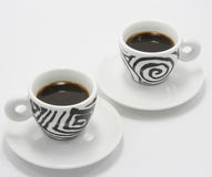 Two cups of coffee. On white background Stock Photos