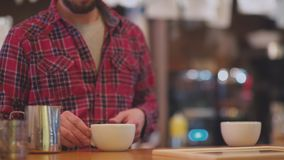 Two cups of coffee. Barista pouring frothed milk in coffee mugs. Coffee for two. Two cups of coffee. Barista pouring frothed milk in coffee mugs. Order at the stock video footage