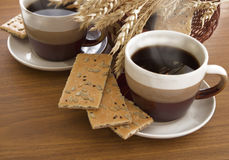 Two cups of coffee and basket Royalty Free Stock Photo