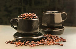 Two cups and coffee beans Stock Photo