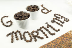 Two cups of coffee beans forming a note Stock Images