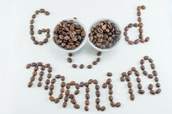 Two cups of coffee beans forming note Stock Photo