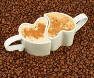Two cups on coffee beans Stock Photo