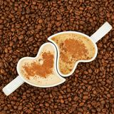Two cups on coffee beans Stock Photography
