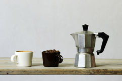 Two cups of coffee and beans and percolator Stock Photo