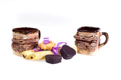 Two cups of coffee with biscuits - dessert for Valentine`s Day in honor of Valentine`s Day. Stock Images