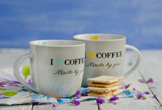 Two cups of coffee with biscuits Stock Photo