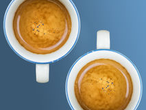 Two cups of coffee. Cups of coffee on blue background Stock Images