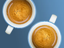 Two cups of coffee. Cups of coffee on blue background Stock Photography