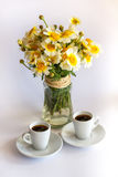 Two cups of coffee and a bouquet of camomiles Royalty Free Stock Photo