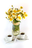 Two cups of coffee and a bouquet of camomiles Royalty Free Stock Photos
